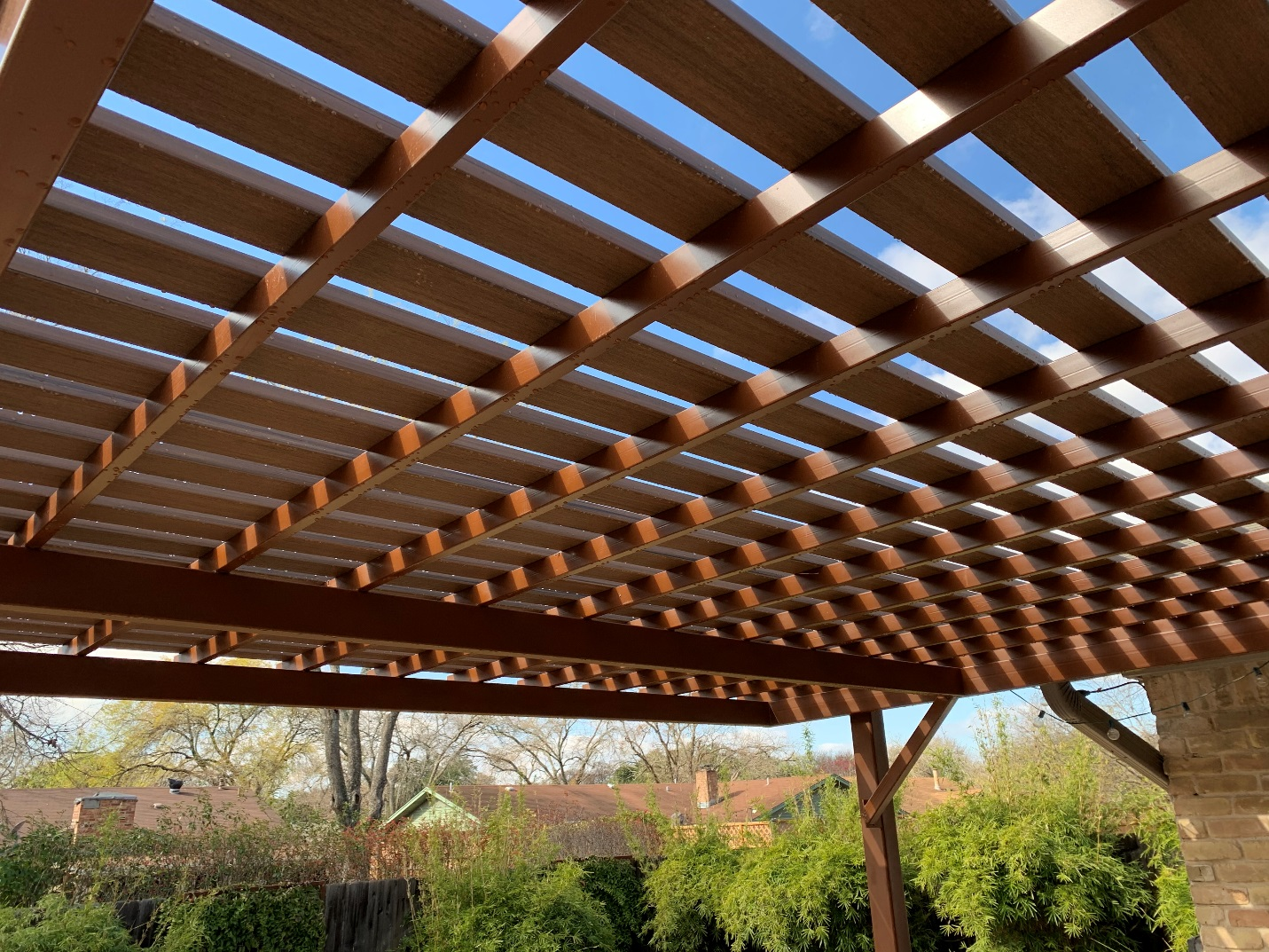PVC-decking-boards-were-used-for-the-pergola's-slats