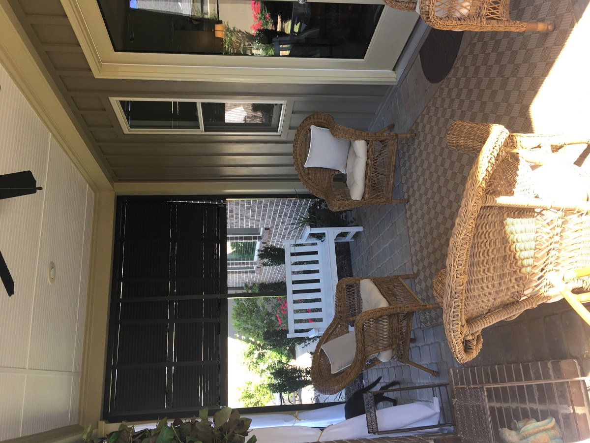 The-interior-of-the-screened-porch-is-welcoming-and-accomodating