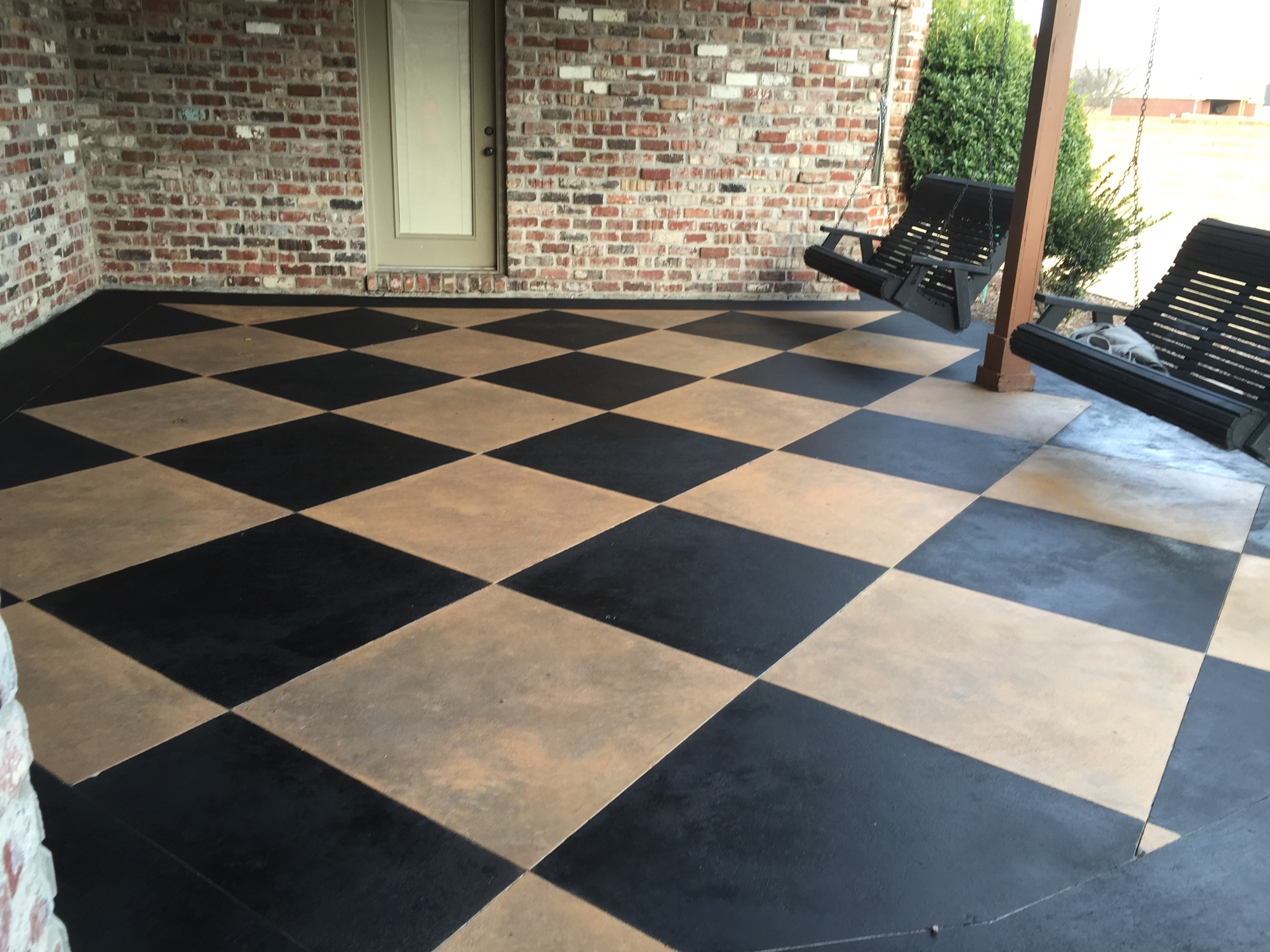 Stamped patio with black and white squares
