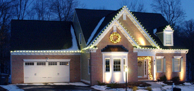 Holiday outdoor lighting enhances the architecture of this home