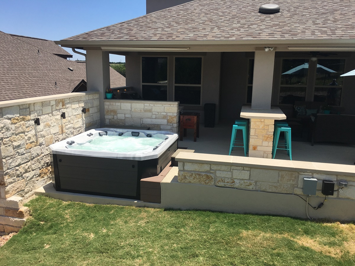 The-hot-tub-area-features-a-custom-AZEK-decking-surround