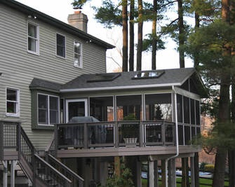 Screened-porch-with-convenient-adjacent-grill-deck
