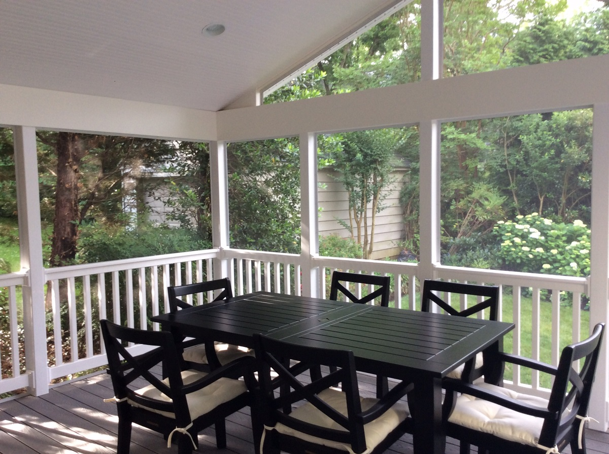 Screened-porch-with-painted-wooden-railing