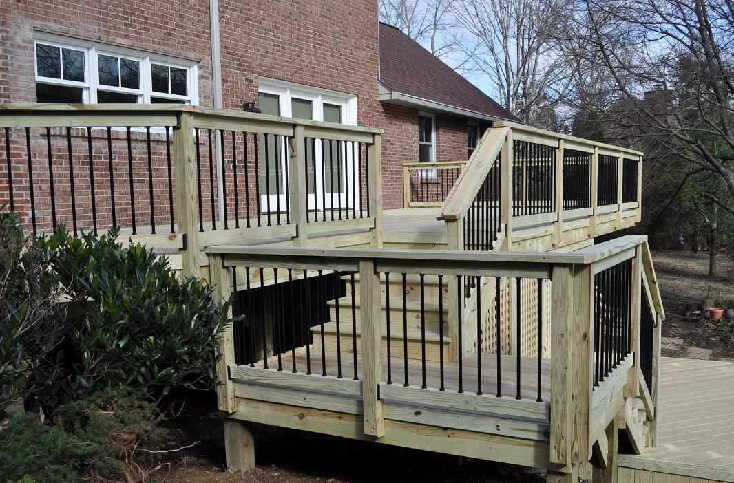 Bi-level-pressure-treated-wooden-deck-addition-in-Oak-Hill-TN