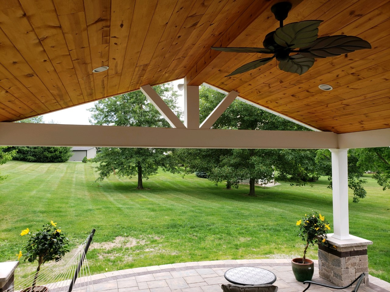 An-open-gable-end-and-ceiling-fan-aids-in-keeping-the-patio-cover-cool-and-comfortable