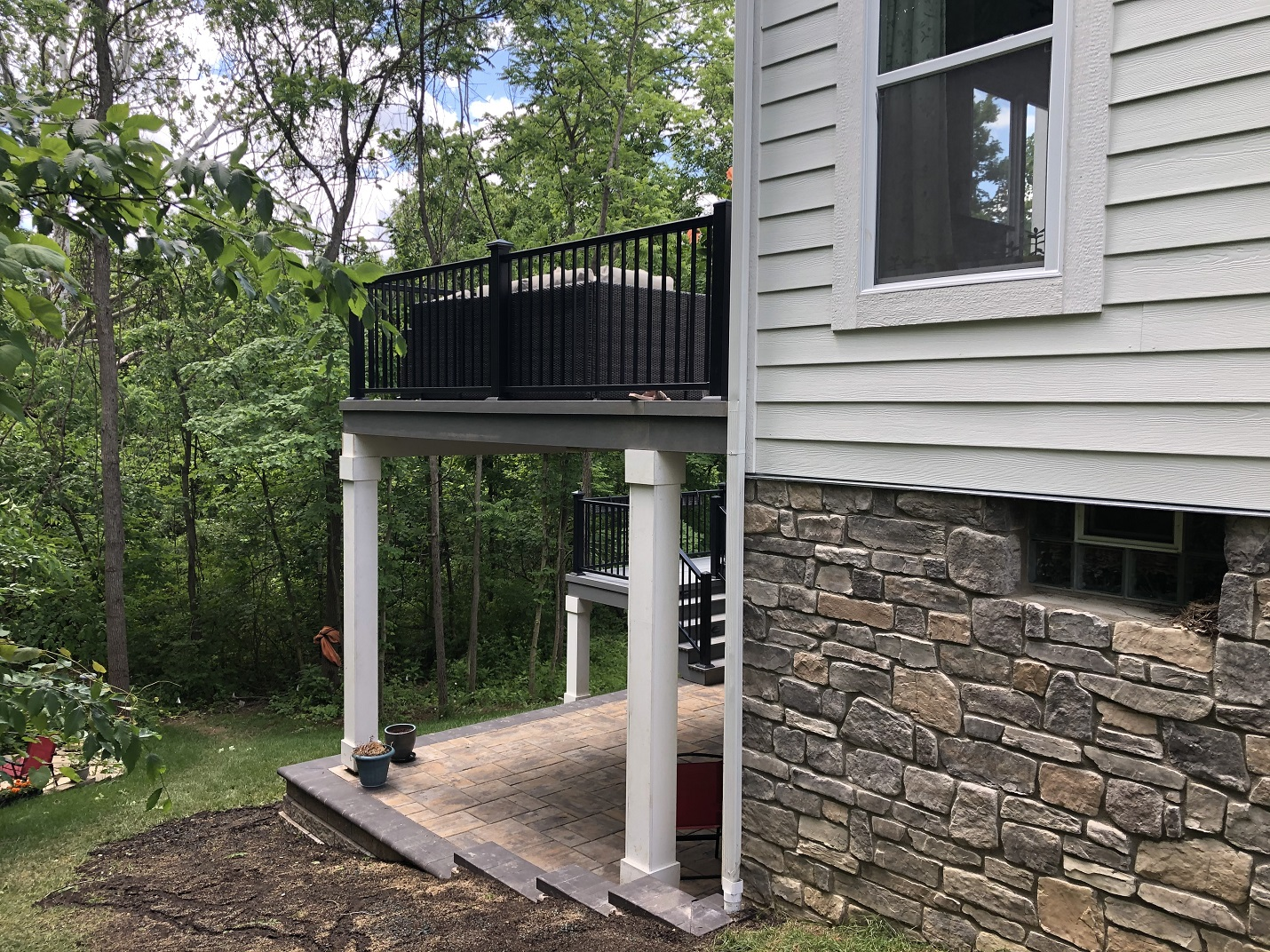 Westerville-TimberTech-deck-and-Unilock-patio