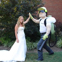 Dread Skeeter high-fiving a bride