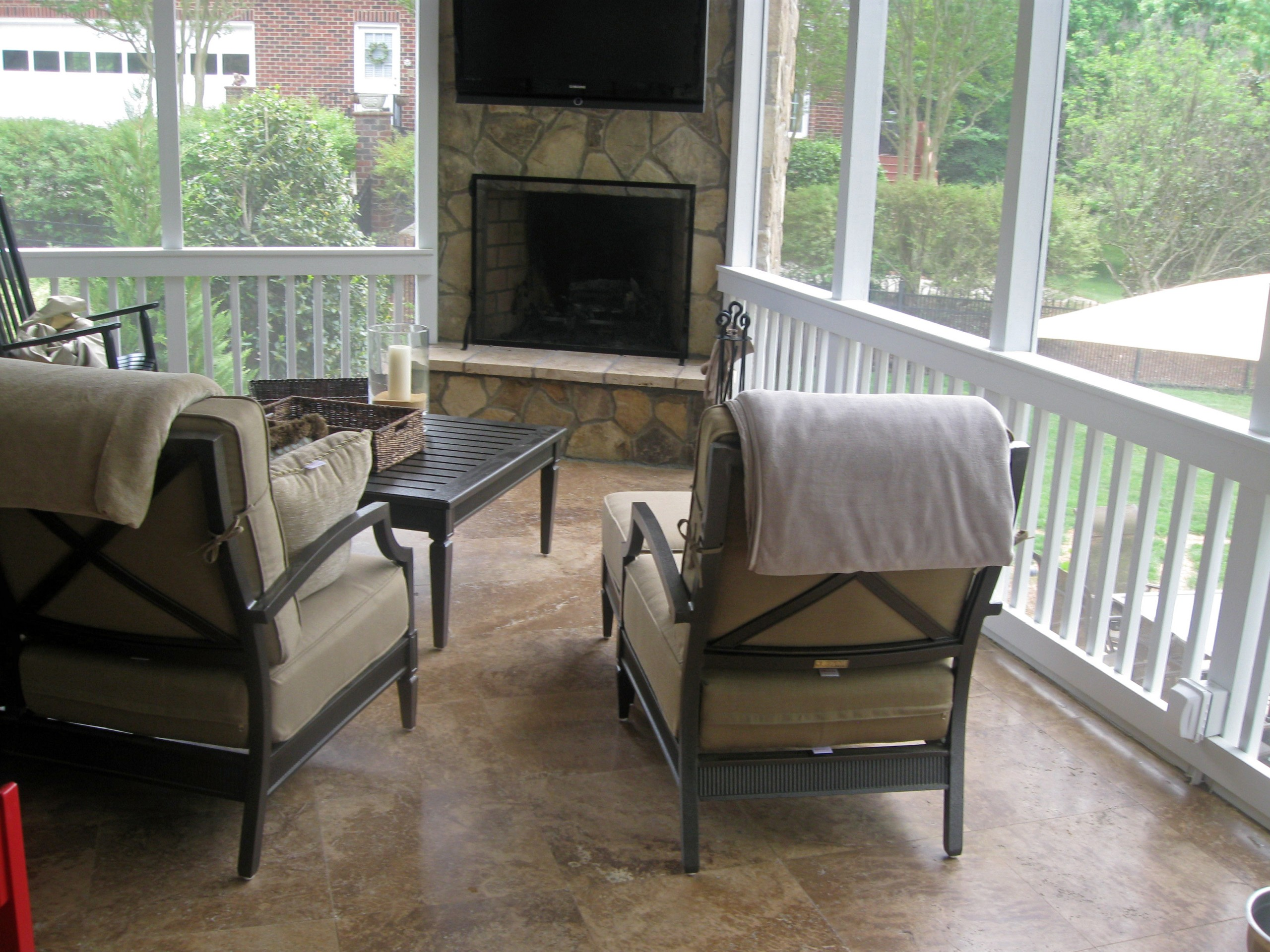 screened porch with travertine tile