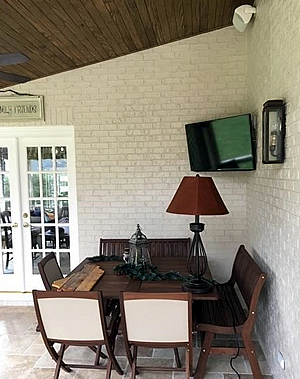 screened porch with TV