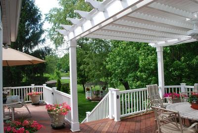 Pergola-on-large-deck-with-overhead-ceiling-fan