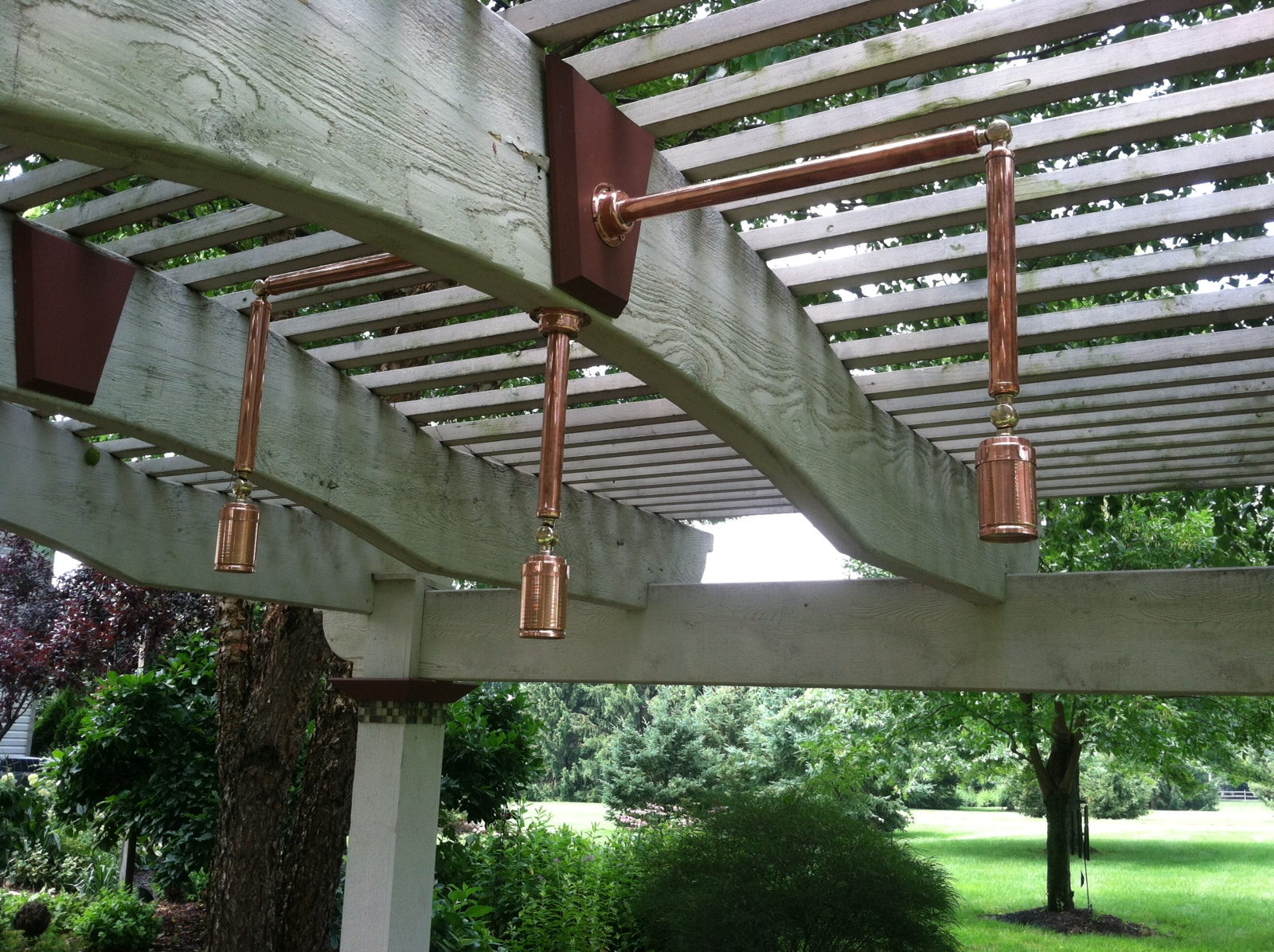 Custom pergola lighting Northern Ohio. Take a look at this stunning pergola lighting. Not only was the lighting design custom for these Northern Ohio area homeowners, but we also had the genuine copper fixtures custom made.