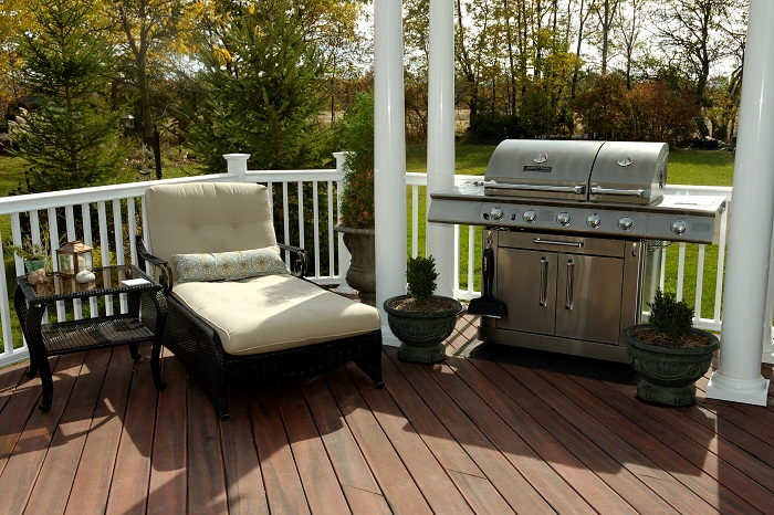 A-man-cave-with-access-to-a-grill-deck-makes-tailgating-a-breeze