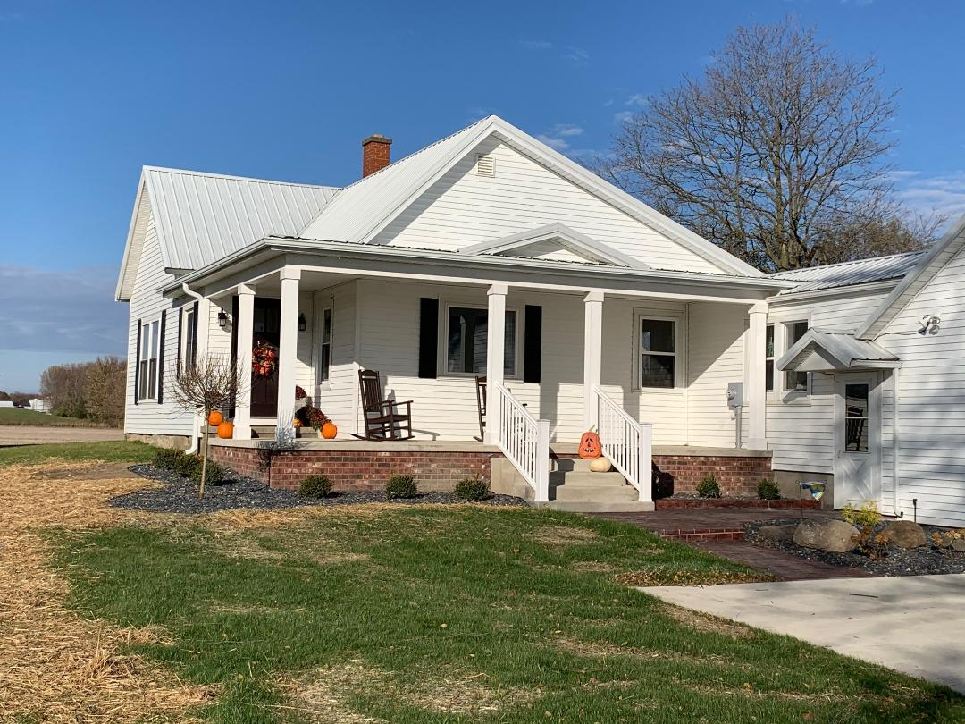 Beautiful-rocking-chair-wraparound-front-porch-addition-by-Archadeck-of-Fort-Wayne