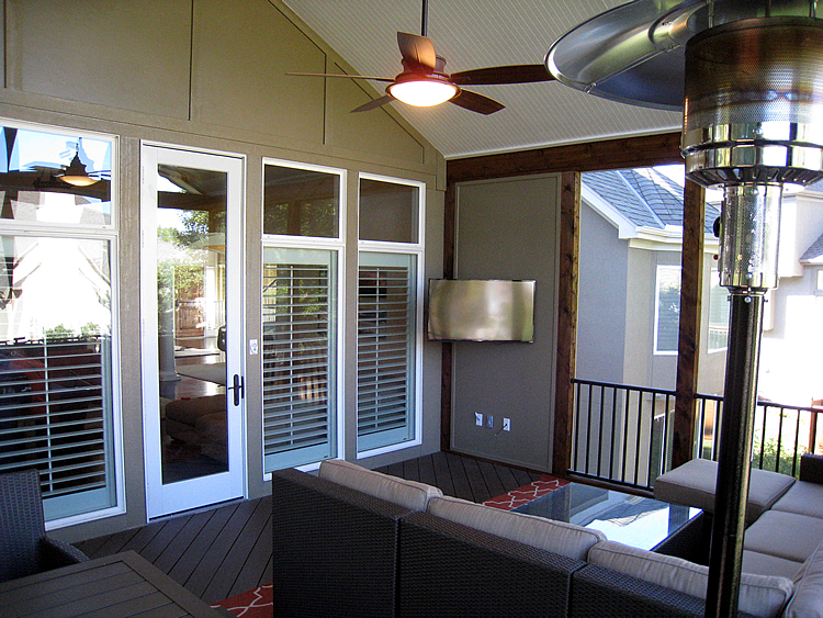 corner TV wall on screened porch