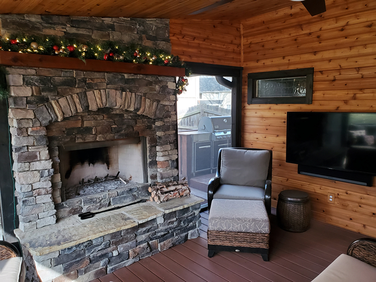 screened porch with cedar TV wall