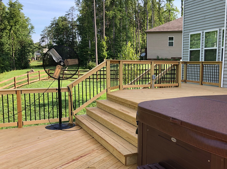 wood deck rail with black pickets