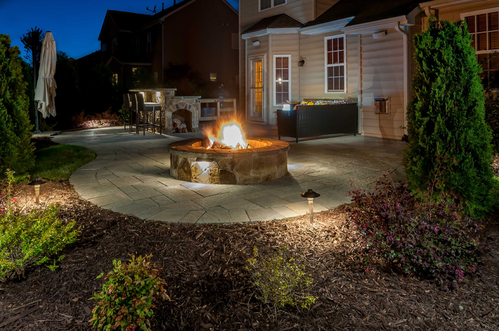 Landscape Lighting Perfection Of Yards Outdoor fireplaces and fire pits have become the must-have patio accessory.  Providing a perfect meeting space for conversing with friends and family in  ...