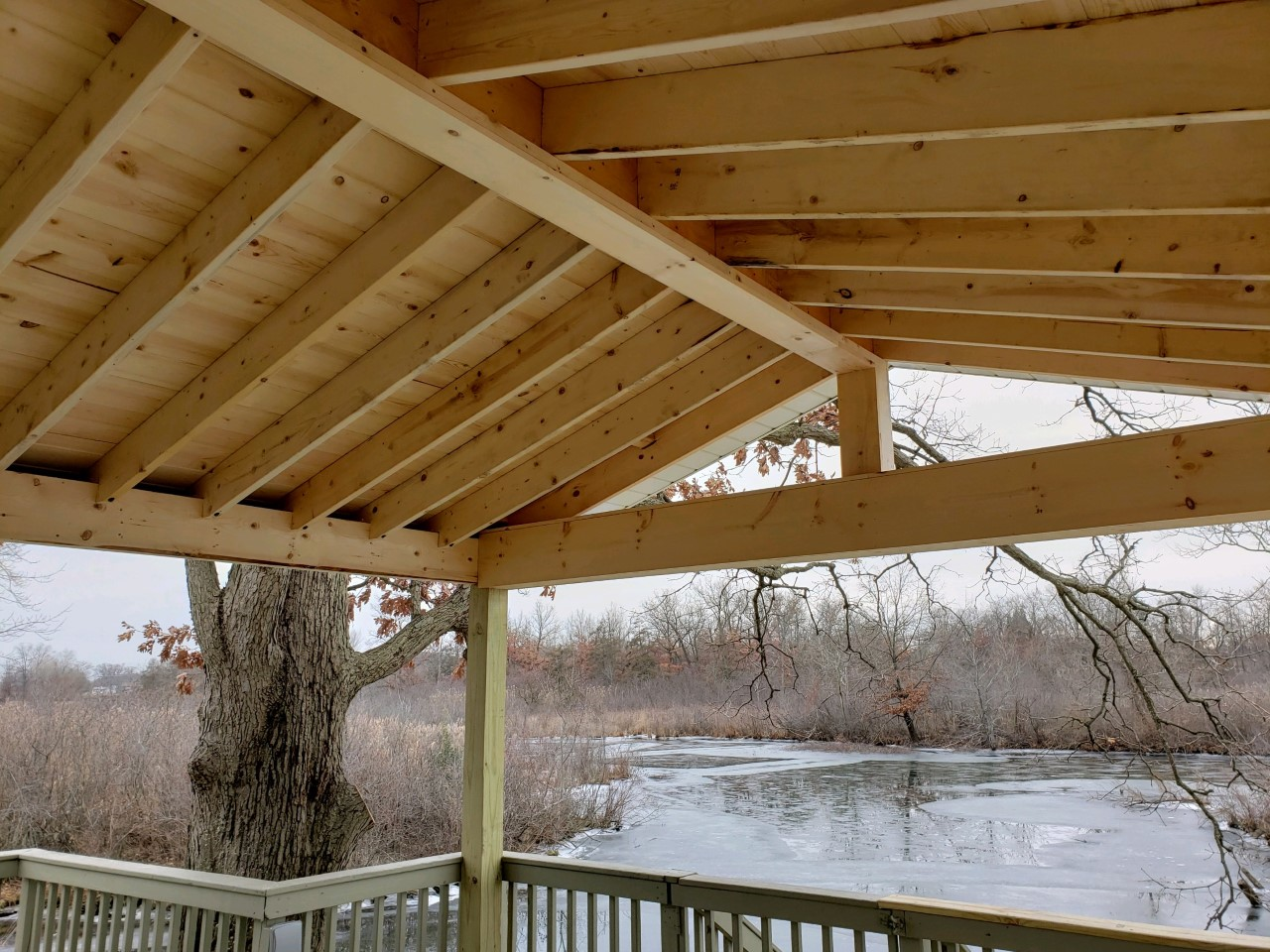 These-clients-enjoy-lakefront-living-on-Portage-Lakes-with-an-amazing-view-from-their-new-covered-deck/porch