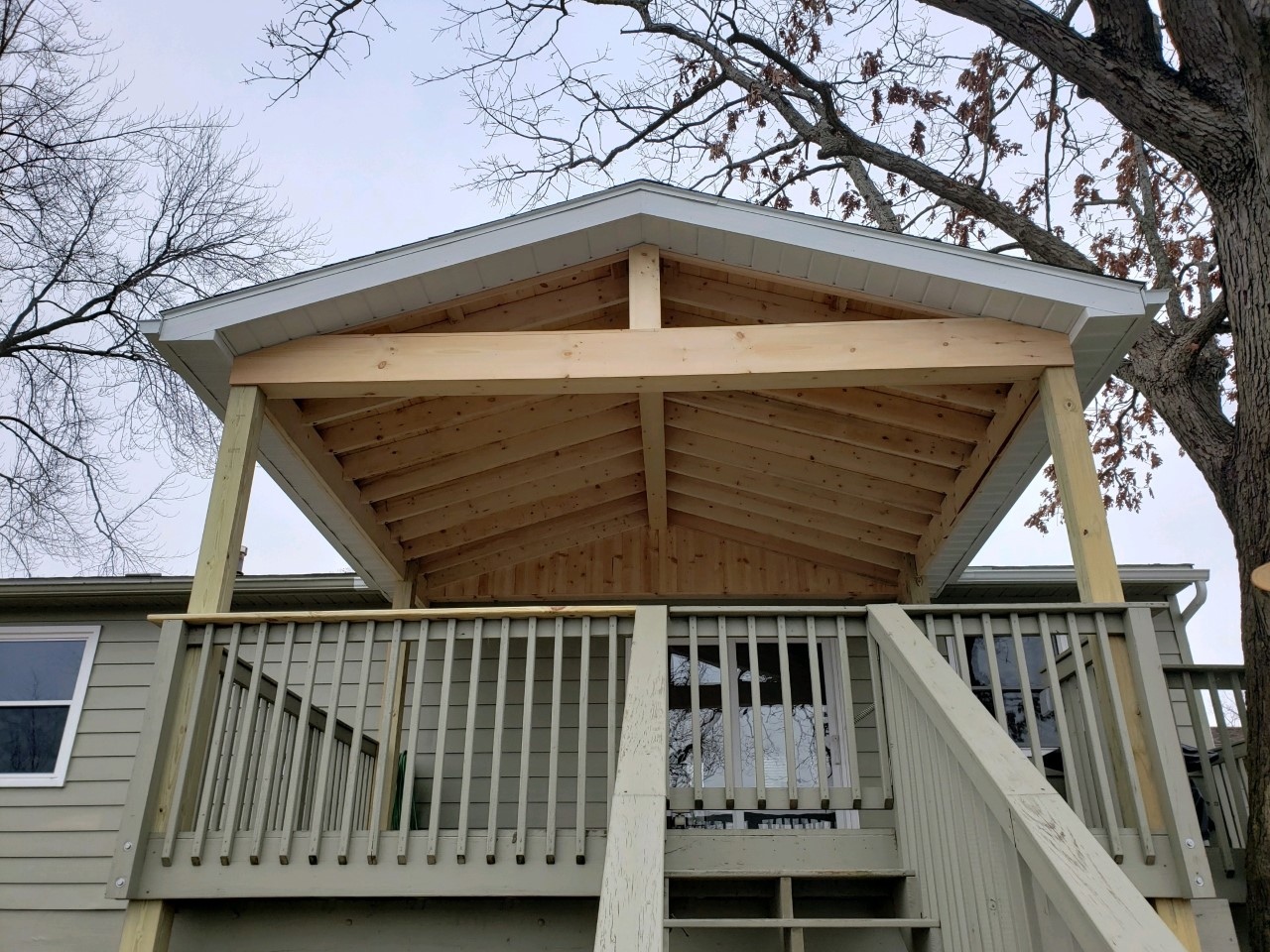 Covered-roof-addition-over-an-existing-deck-in-Portage-Lakes