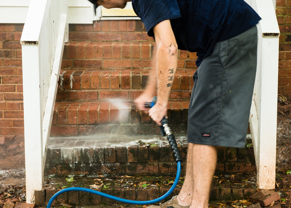 Pressure washing brick steps