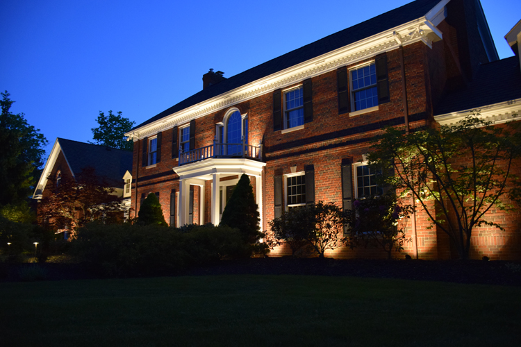 beautiful outdoor lighting. Brick Home With LED Facade Lighting Illuminates The Texture Beautiful Outdoor W