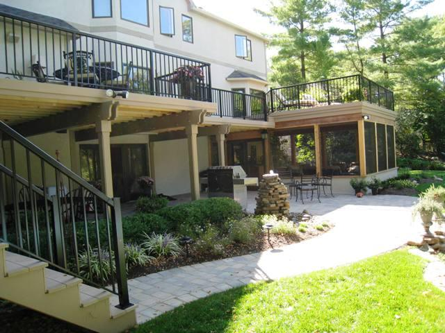 Outdoor-living-combination-with-double-decks-and-screened-porch-with-patio-below