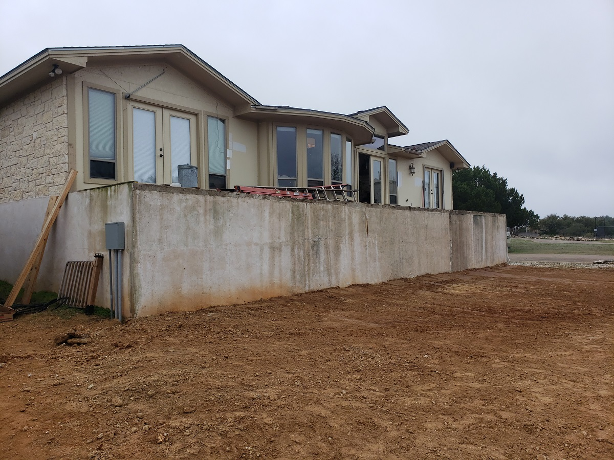 Archadeck-of-Austin-began-the-project-by-tearing-the-space-down-to-the-existing-concrete-patio