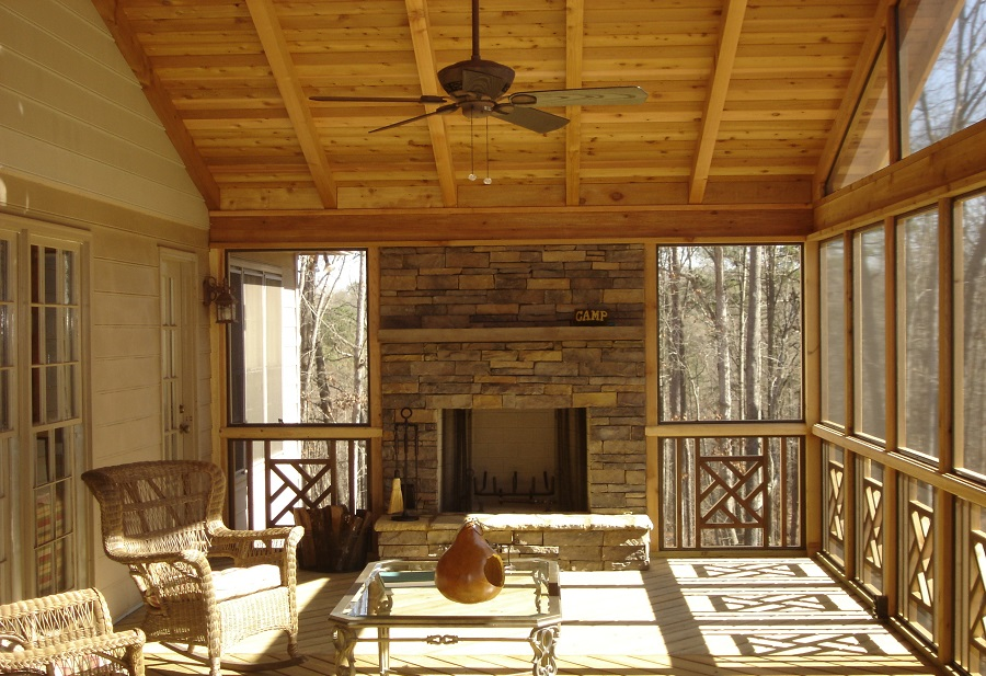 Rustic-screened-porch-with-stone-fireplace