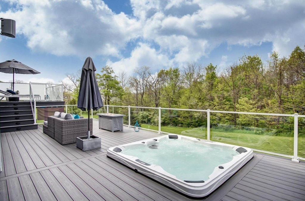 Spacious-bi-level-sun-deck-and-hot-tub-deck-combine-to-offer-endless-outdoor-living-opportunities