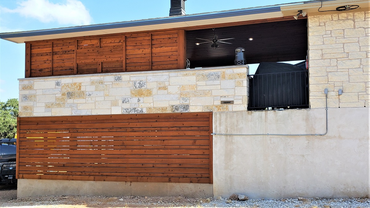 View-of-outdoor-kitchen-with-priacy-wall-from-exterior