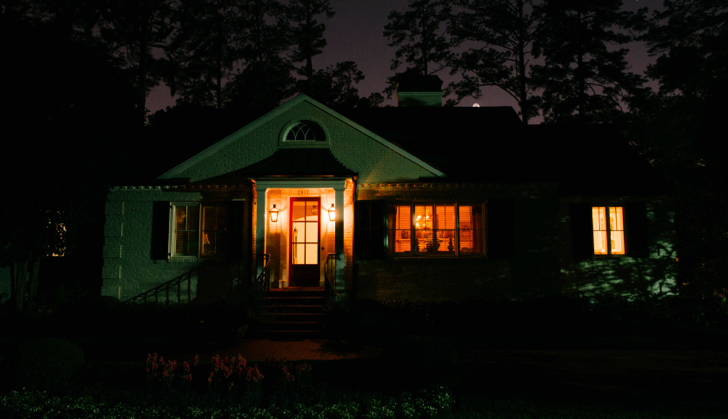 Architectural lighting brings white ranch back to life at night here is the house before outdoor lighting perspectives came to visit as you can see there are two small coach lights on the front porch but unfortunately aloadofball Choice Image