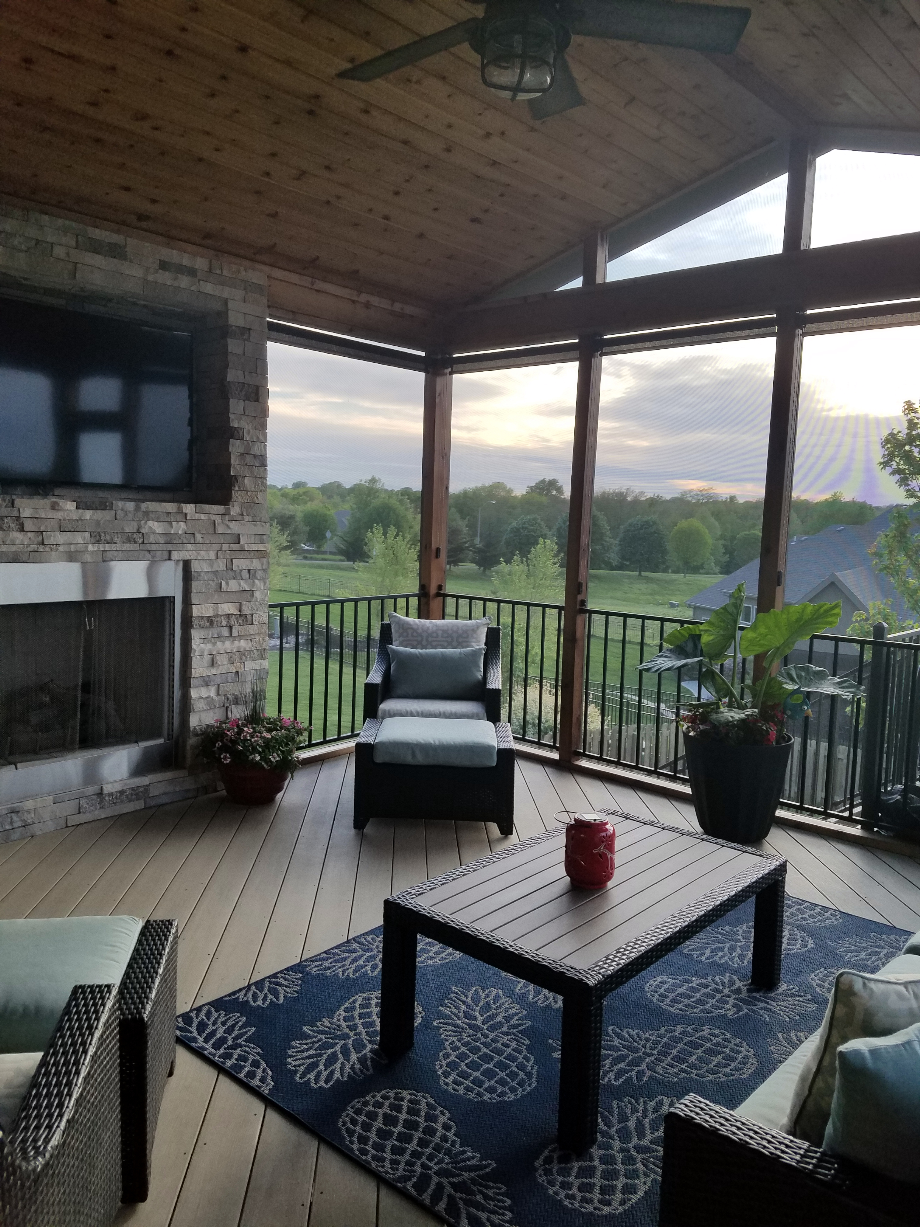 Raymore MO screened porch with TV