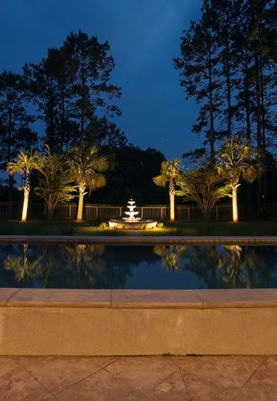 Feature-lighting-gives-this-outdoor-fountain-elegant-appeal-at-night