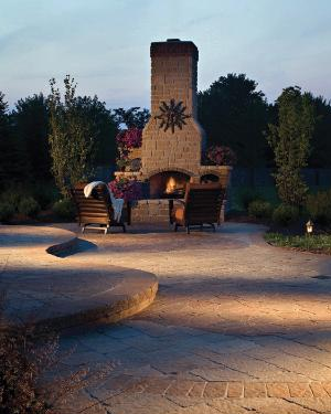 curved patio with outdoor fireplace