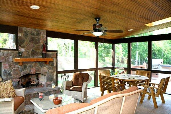 sunroom with outdoor fireplace