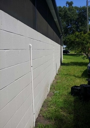 We-ran-the-wiring-for-these-sconces-outside-and-blended-them-into-the-concrete-wall