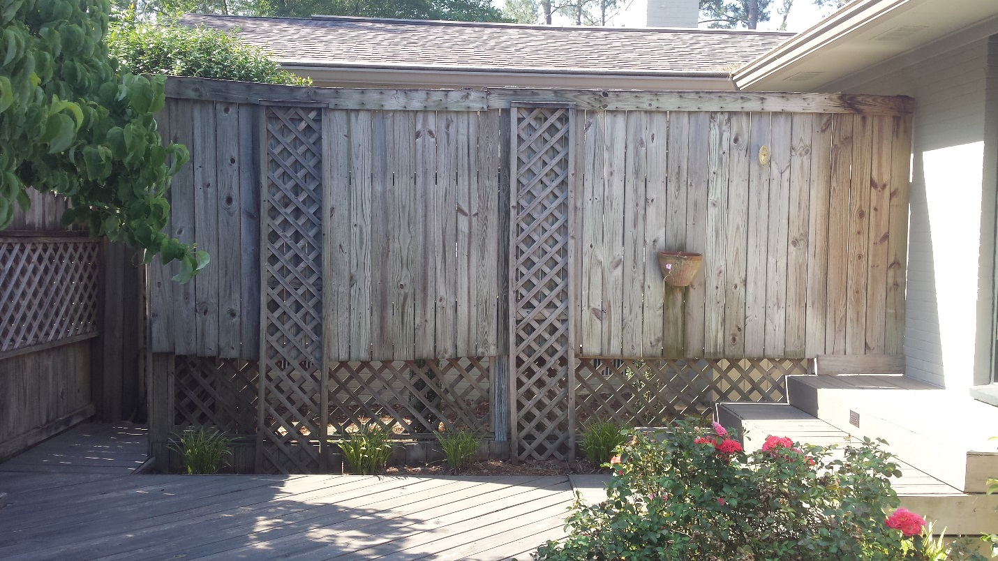 Existing-wooden-deck-and-privacy-wall-before-we-began-project