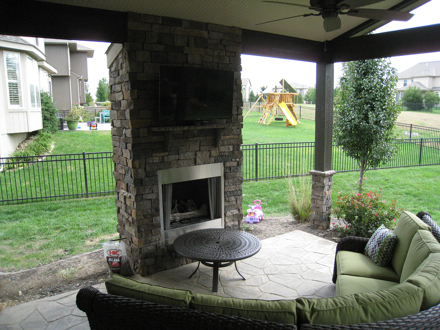 With a roof, this Olathe patio is simply a whole different ... on Outdoor Gas Fireplace For Deck id=44969