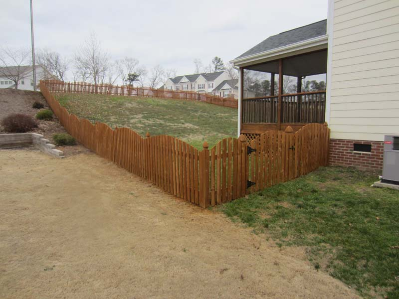 wood fence cleaned and stained by Renew Crew of the Triangle