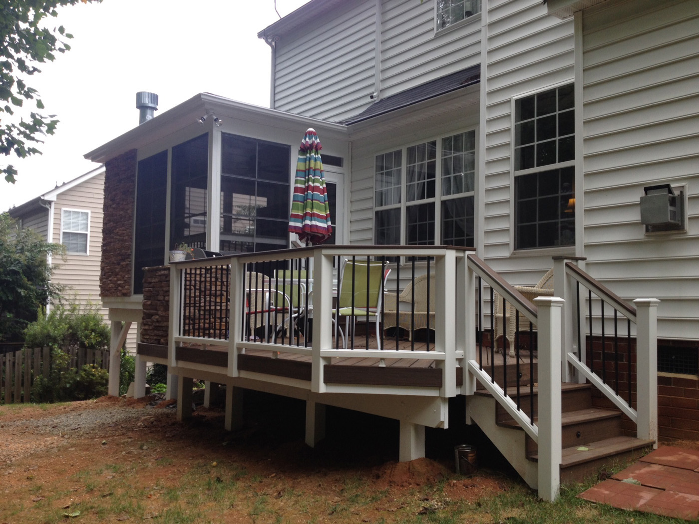 Low Maintenance Raleigh Deck With Contrasting White Posts Black Balusters