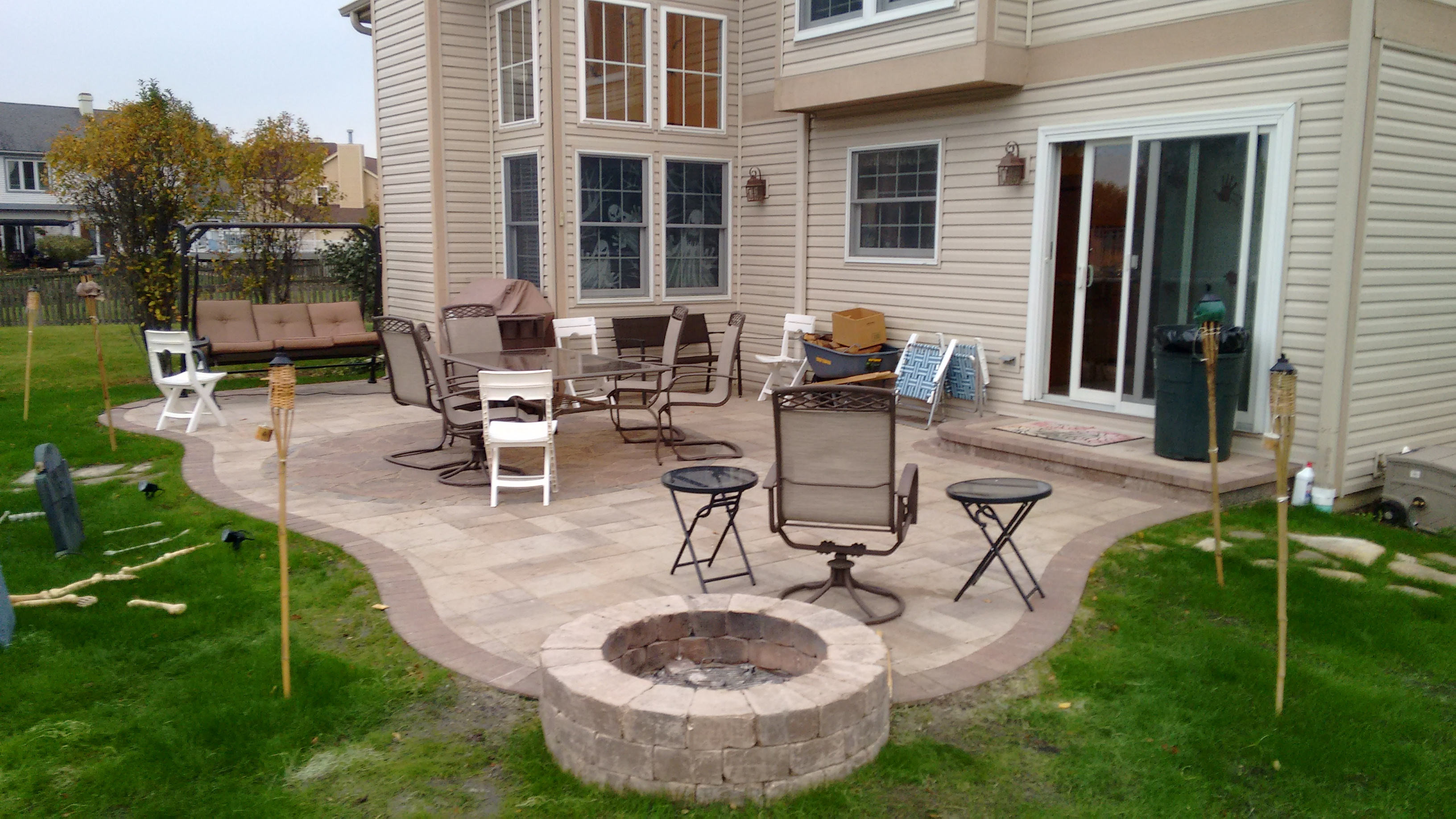 Belgard Patio with built in fire pit in Bartlett, IL by Archadeck of Chicagoland Thumbnail