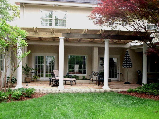 wood pergola with white columns