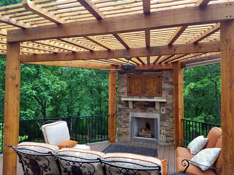 pergola and outdoor fireplace atop low maintenance deck
