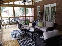 This-screened-porch-is-used-as-an-outdoor-living-room