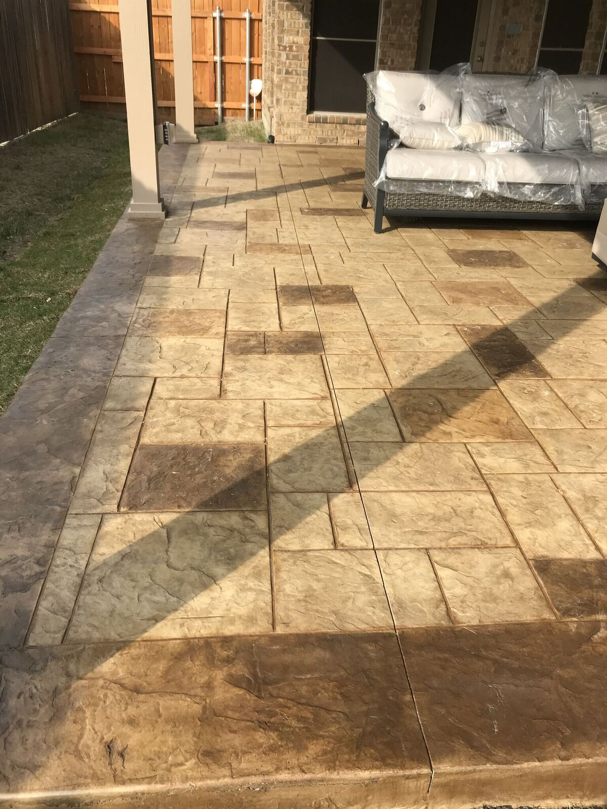 We-added-a-stunning-stain-and-stamp-overlay-to-the-concrete-patio