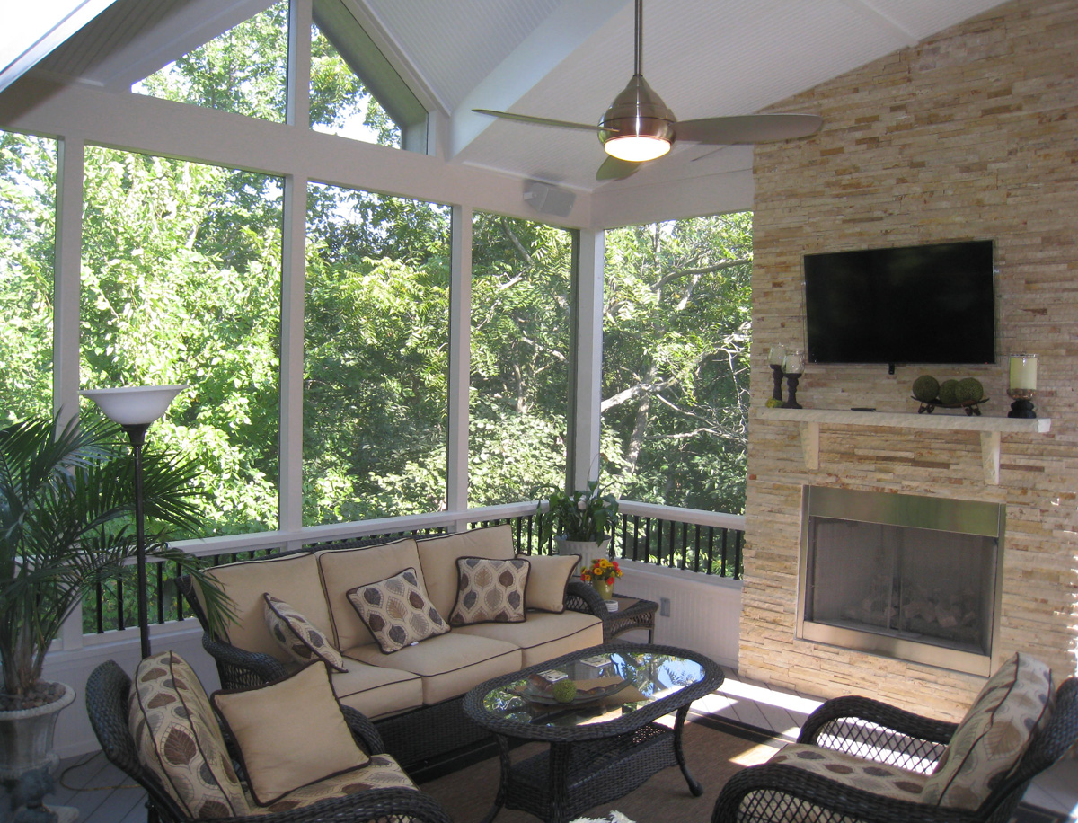 Raleigh screened porch with fireplace and railings