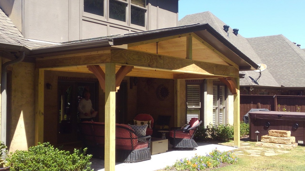 A-gable-roof-and-decorative-brackets-add-instant-charm-to-this-covered-porch