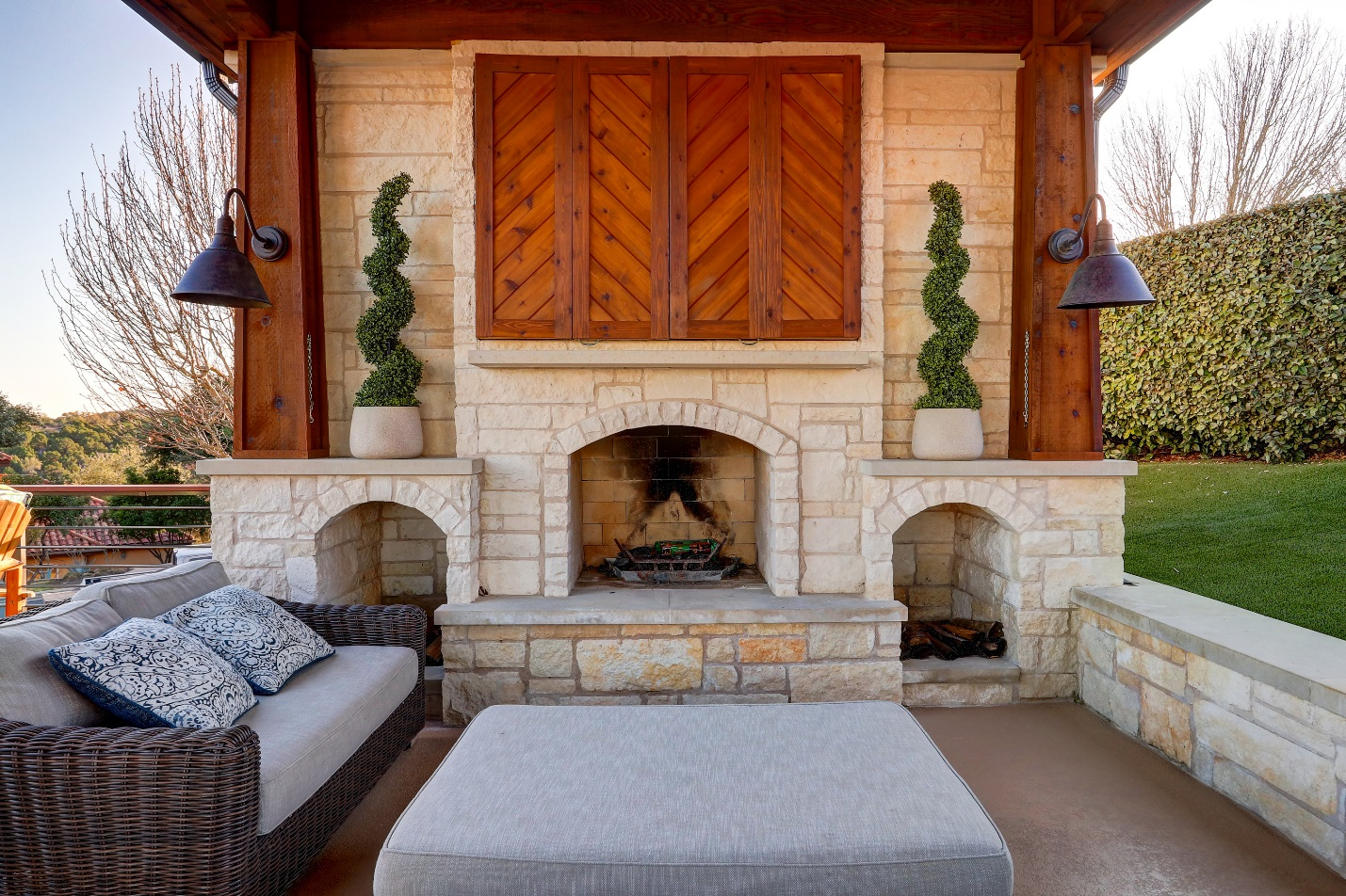 This-breathtaking-custom-limestone-fireplace-commands-attention-in-this-space