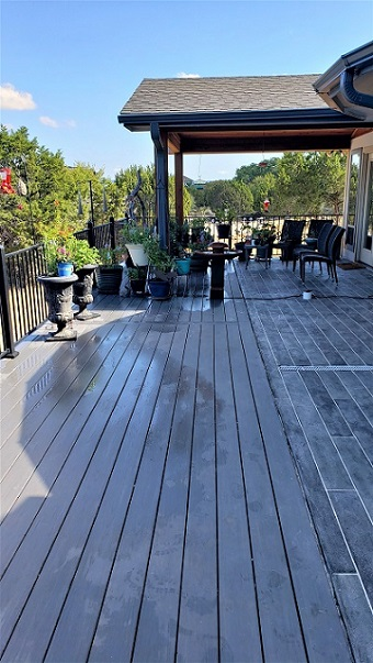 This-image-show-the-textured-concrete-finished-surface-and-the-new-decking-side-by-side