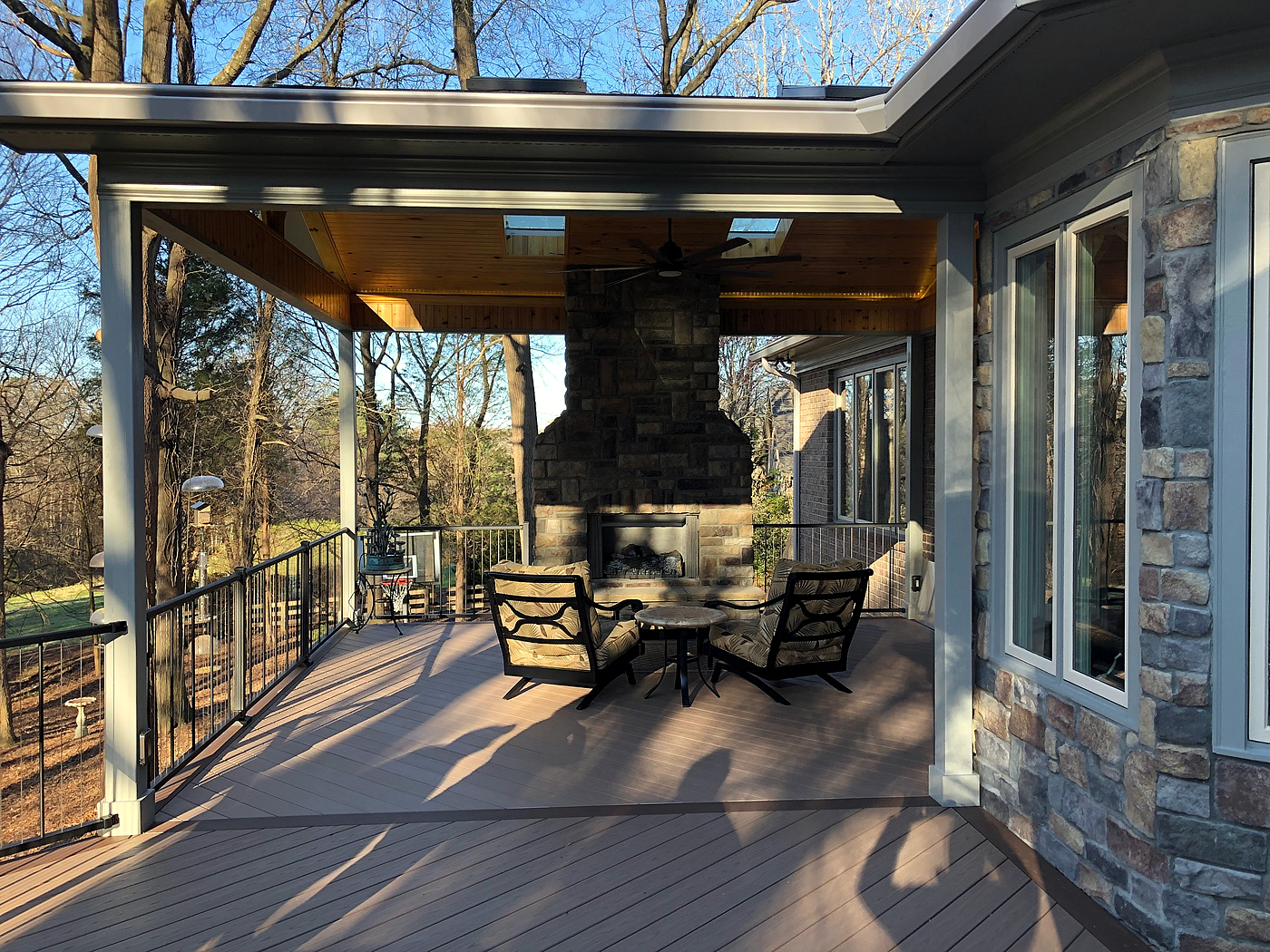 deck and porch with fireplace